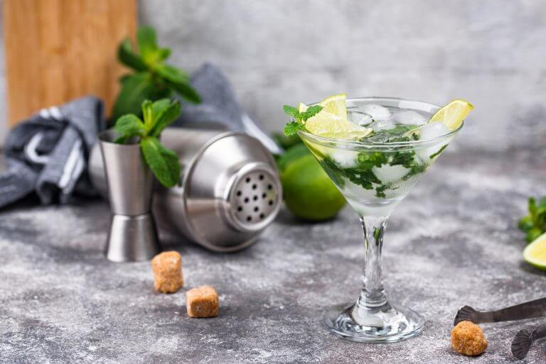Martini cocktail with lime and mint