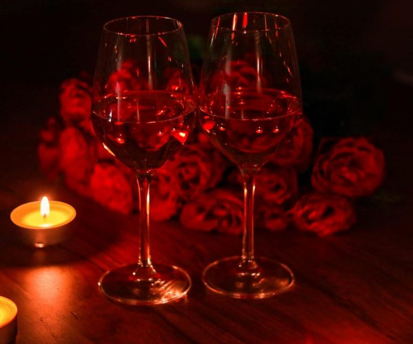 Romantic dinner with candles and wine. Proposal night.